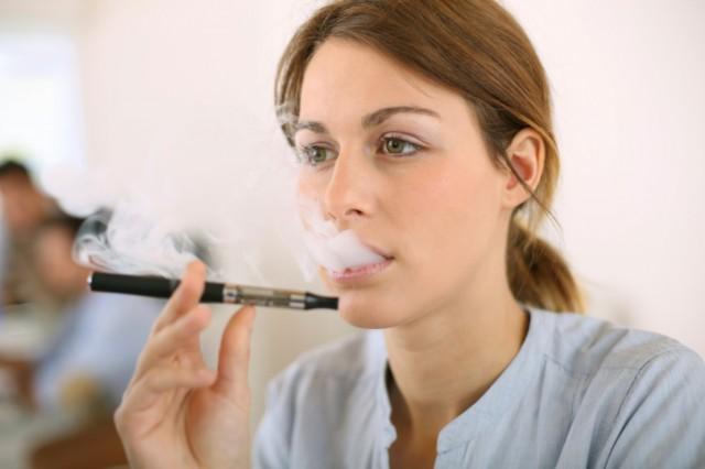 Woman smoking e-electronic