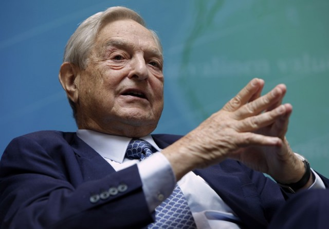 Billionaire investor George Soros speaks at a forum Charting A New Growth Path for the Euro Zone during the annual IMF-World Bank meetings in Washington September 24, 2011.   REUTERS/Yuri Gripas (UNITED STATES - Tags: POLITICS BUSINESS)