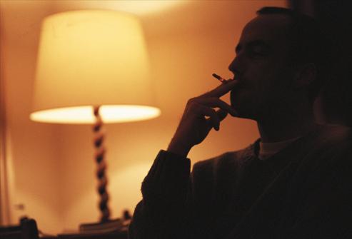 getty_rf_photo_of_man_smoking_at_night