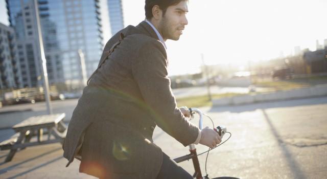 man-riding-bicycle-on-city-street-2