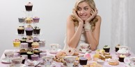 Woman with table of tea and cakes  Image downloaded by John O'Reilly at 12:26 on the 15/06/11