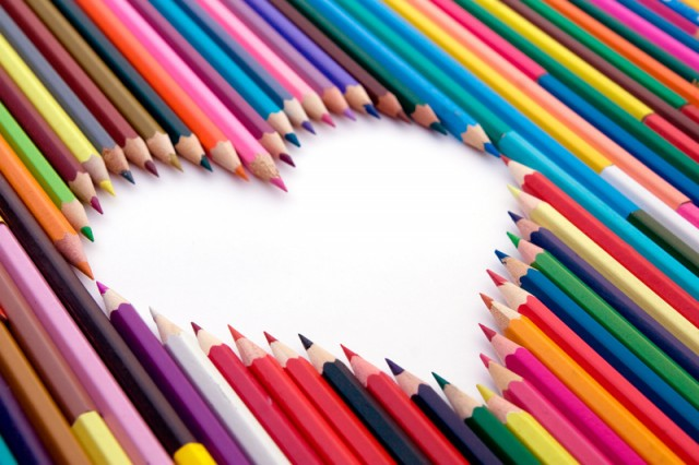 A lot of crayons and the white heart
