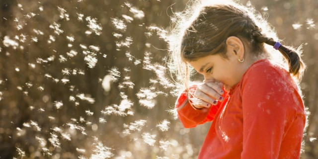 Girl suffering from allergies outdoors