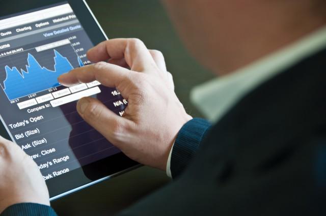 Closeup of a businessman accessing his digital tablet PC